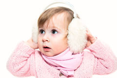 Little girl in fur headphones Royalty Free Stock Images