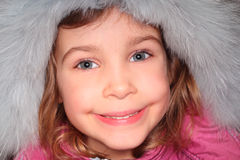 Little girl in fur hood, looking at camera Stock Photo