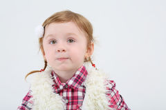 Little girl in fur vest grimaces and looks away Stock Images