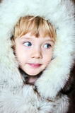 Little girl in furs royalty free stock image