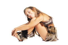 Little girl in the furs as a prehistoric Royalty Free Stock Photo
