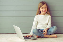 Little girl with gadget Royalty Free Stock Image