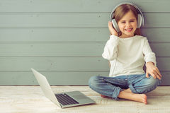 Little girl with gadget Stock Photos