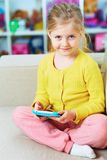 Little girl game play in tablet. Entertaiment stock photo