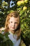 Little girl in the garden Stock Photos