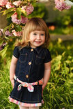 Little girl in garden Stock Photo