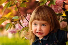 Little girl in garden Royalty Free Stock Photo