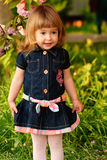 Little girl in garden Royalty Free Stock Image