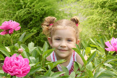 Little girl in garden Royalty Free Stock Images