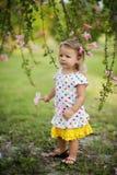 Little girl in garden royalty free stock photography
