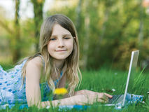 Little girl in garden Royalty Free Stock Photos