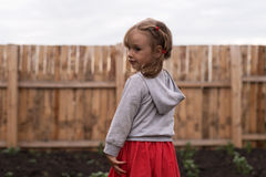 Little girl in the garden Royalty Free Stock Images