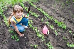 Little girl in garden Stock Photography