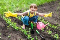 Little girl in garden Royalty Free Stock Image
