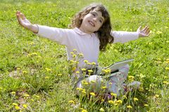 Little girl on garden meadow notebook computer Royalty Free Stock Image