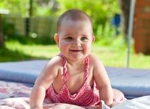 Little girl in the garden Royalty Free Stock Photos