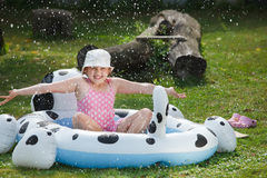 Little girl in garden pool Stock Images