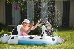 Little girl in garden pool. Having fun Royalty Free Stock Photo