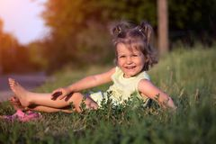 Little girl at the garden stock images