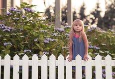 Little girl in garden. At  sunset Stock Photo