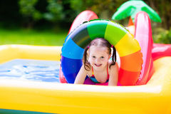 Little girl in garden swimming pool Royalty Free Stock Photo