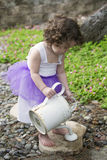 Little girl in the garden Royalty Free Stock Image