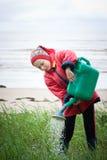 Little girl gardener. Watering flowers stock image
