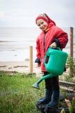Little girl gardener. Watering flowers royalty free stock photos