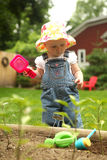 A little girl gardening Stock Photos
