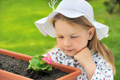 Little girl gardening Stock Photos