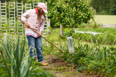 Little girl gardening Stock Images