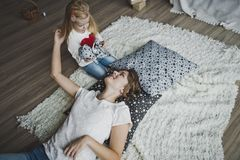 The little girl gently, stroking the mother 7346. Stock Photography