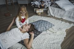 The little girl gently, stroking the mother 7349. Stock Photography