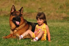 Little girl with german shepard Royalty Free Stock Photography