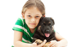 Little girl and a German Shepherd puppy on white b. Portrait of a little girl and a German Shepherd puppy on white background royalty free stock images