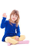 Little girl gesturing hello. Sitting Stock Image