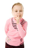 Little girl gesturing silence sign. Attractive little girl gesturing silence sign isolated over white background Stock Images