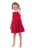 Little girl gesturing thumbs up. Cute little girl wearing red dress, gesturing thumbs up, isolated Royalty Free Stock Images