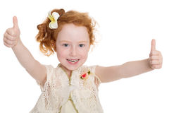 Little girl gesturing thumbs up Stock Photos