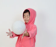Little girl is  get the ball. Stock Images