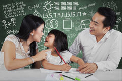 Little girl get a pressure to study Stock Image