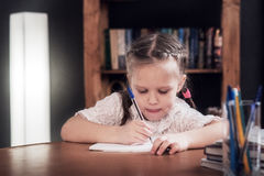 Little girl gets education Royalty Free Stock Photos