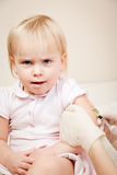 Little girl gets an injection Royalty Free Stock Photography