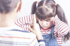 Little girl gets a scolding stock photos