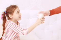 Little girl getting glass of milk Royalty Free Stock Photos
