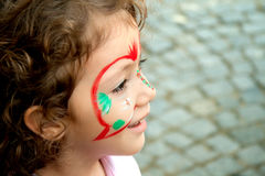 Little Girl Getting Her Face Painted Stock Images