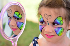 Little girl getting her face painted Royalty Free Stock Images