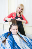 Little girl getting her new haircut Stock Image