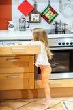 Little girl getting tableware before dinner. Little girl getting tableware from table case before dinner Stock Image