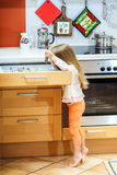 Little girl getting tableware before dinner Stock Photo